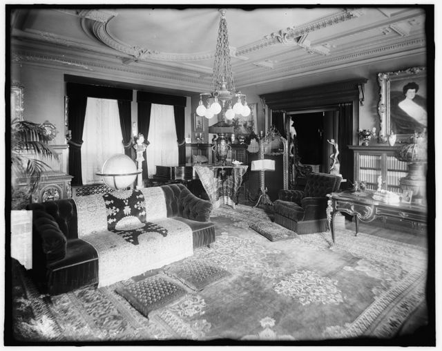 [Living room with double windows and world globe]