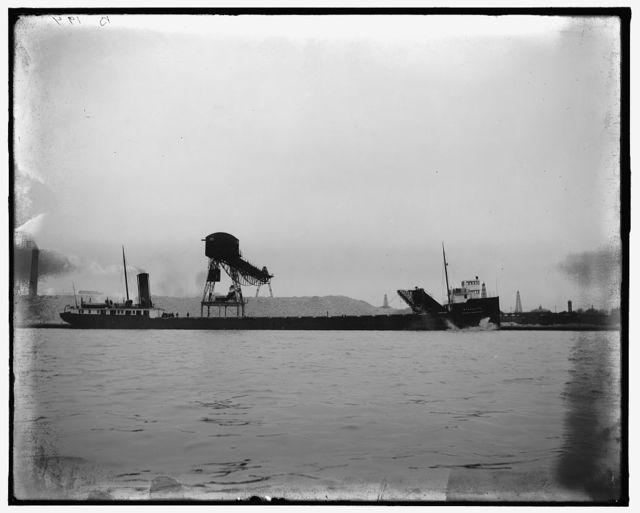 [Loading ore or coal onto cargo ship Wyandotte]