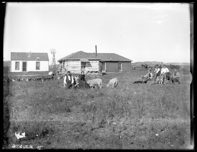 Log, sod, and frame houses on the Quisenbury Ranch on the Snake River in Cherry County, Nebraska.