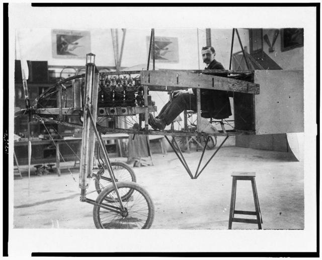 """[Louis Blériot at the helm of his monoplane, furnished with """"automatic"""" motor of 50 h.p.]"""