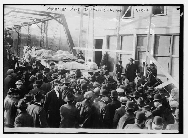 Marianna Mine Disaster, carrying the dead on stretchers, Marianna, PA.