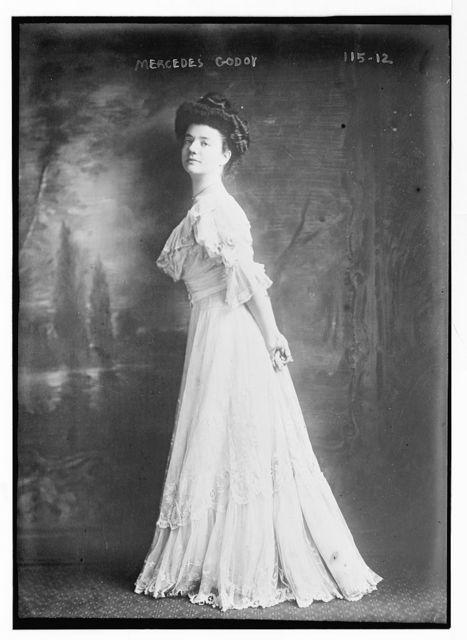 Mercedes Godoy, standing