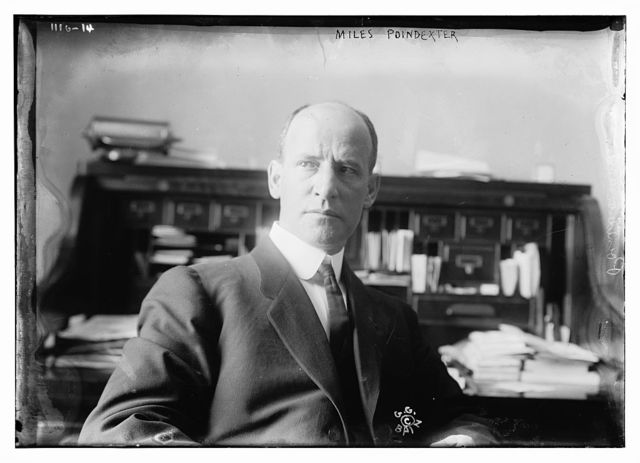 Miles Poindexter seated at desk