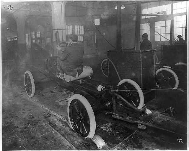 [Model T's coming off the assembly line at the Highland Park plant]