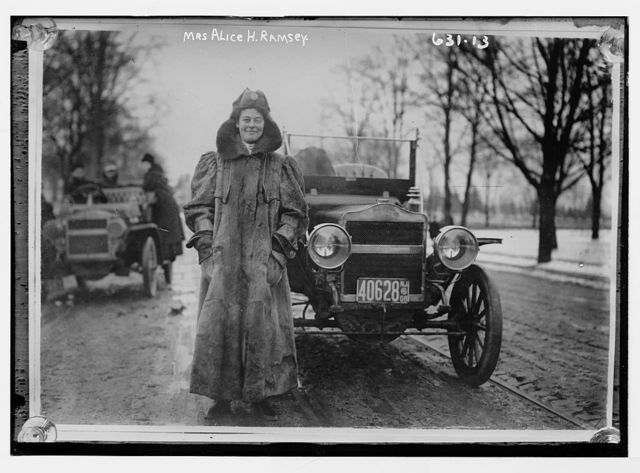 Mrs. Alice H. Ramsey, standing beside her auto