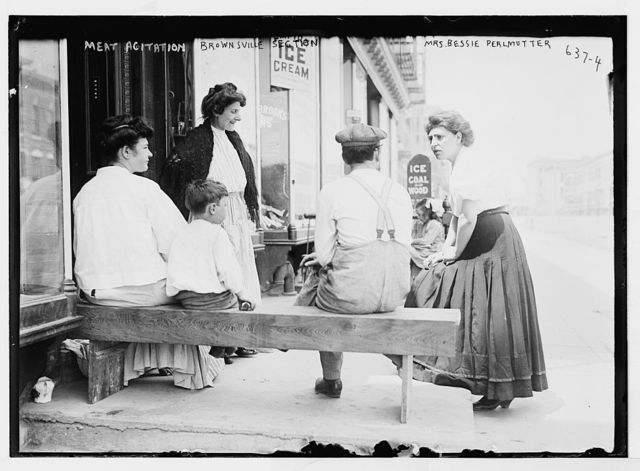 Mrs. Bessie Perlmutter and others outside store, meat agitation, New York, Brownsville Section