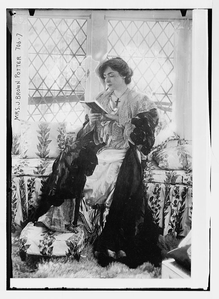 Mrs. J. Brown Potter, seated reading