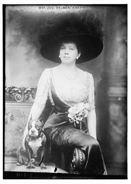 Mrs. Joseph Palmer Knapp seated with dog