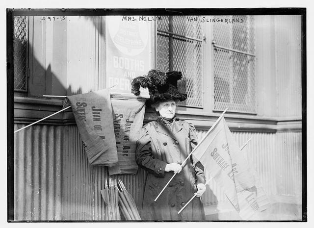 Mrs. Nellie van Slingerland holding banner of Joan of Arc Suffrage League