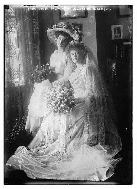 Mrs. Roger M. Minton and Justine Ingersoll seated holding bouquets