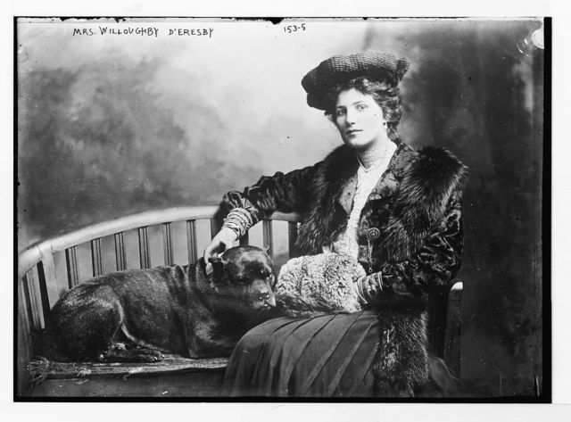 Mrs. Willoughby D'Eresby, seated with dog