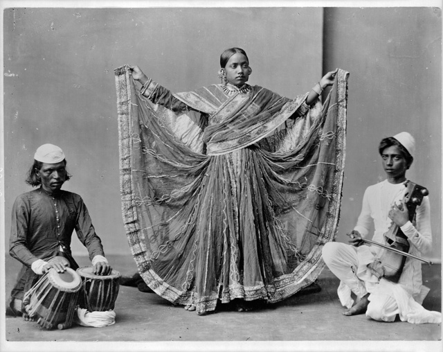 Nautch girl dancing with musicians accomp. Calcutta, India
