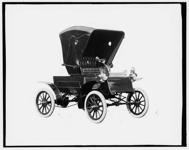 [Northern Manufacturing Company automobile, front-quarter view with top]