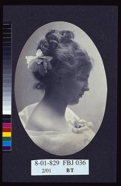 [Oval portrait of woman with a flower in her hair and a corsage on her dress] / Miss Elton, Cleveland, Ohio.