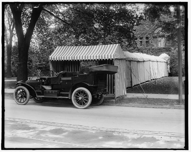 [Packard automobile and tented entrance to club or dwelling, Mich.]