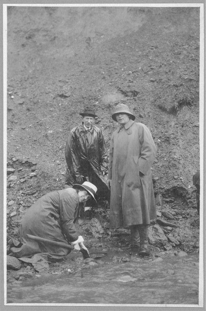 Panning gold in a shovel at Pioneer Mine - Frank G. Carpenter in center, J. Lindeberg at right
