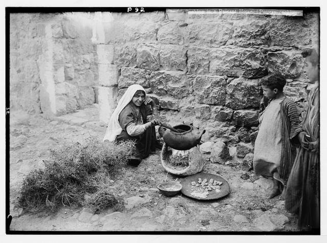 Peasant types. Cooking in a peasant home. (Pottery cooking pot and thorn fire)