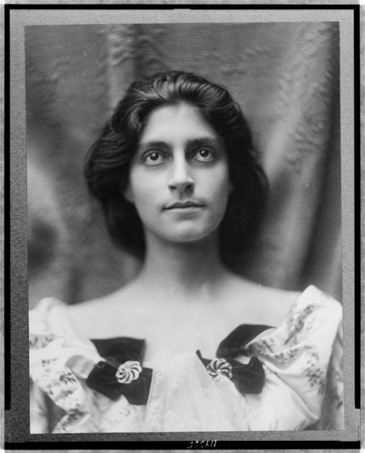 [Portrait of a woman in a floral dress adorned with diamond brooches and bows]