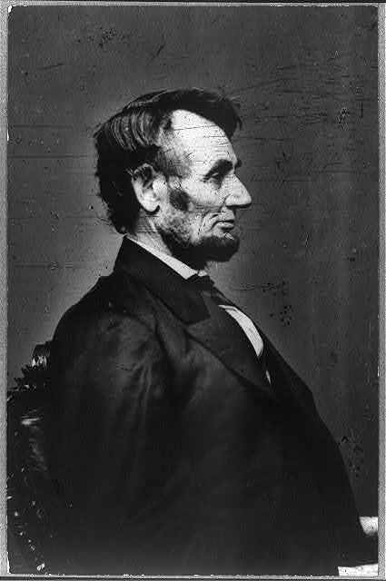 [President Abraham Lincoln, half-length portrait, seated, right profile]
