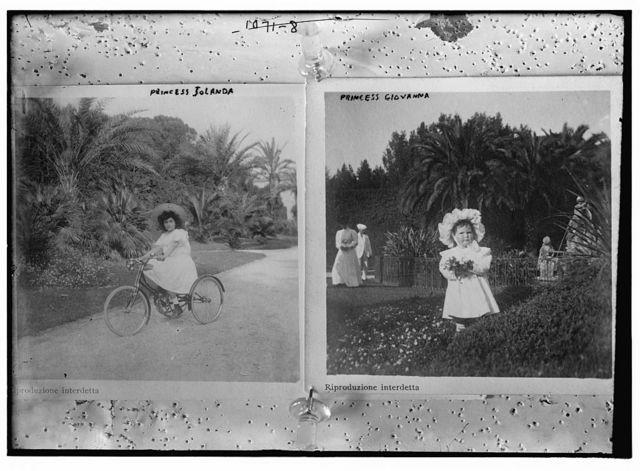 Princess Jolanda on bicycle; Princess Giovanna in garden holding flowers
