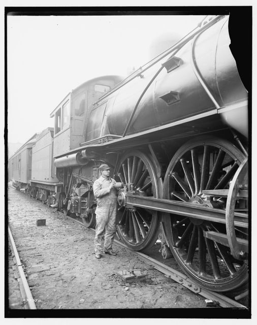 [Railroad engineer oiling up before the start]