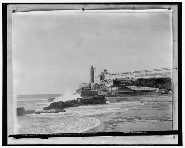 Raising the American flag on Morro Castle, Havana, at noon, Jan. 1, 1899