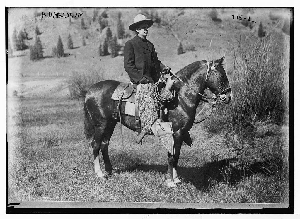 R.D. Meldrum, in cowboy outfit, on quarter horse