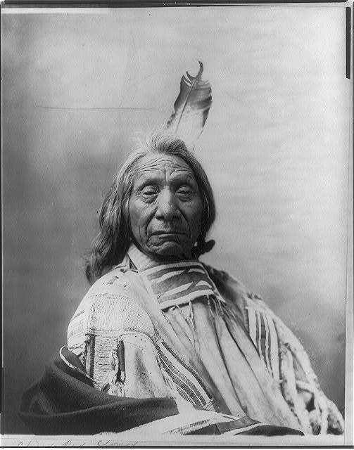 [Red Cloud, Chief, head and shoulders portrait, facing slightly right, wearing one feather]