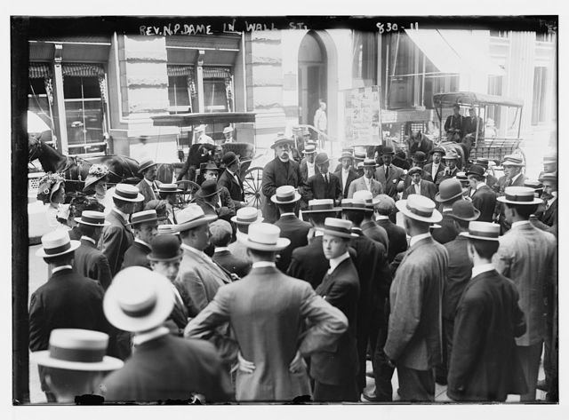 Rev. Dame speaking to crowd on Wall St., New York