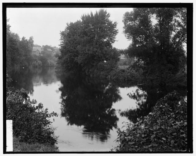 [River with buildings in background, probably the Huron River, Ypsilanti, Michigan]