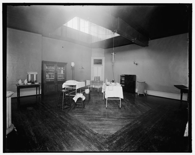 [Room with medicine cabinet, basins, and massage or treatment table, probably the Ypsilanti mine bath house, Ypsilanti, Mich.]