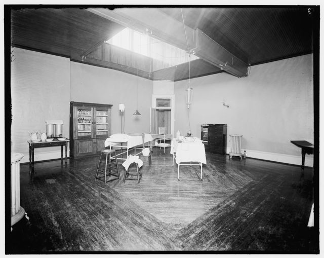 [Room with medicine cabinet, basins, and massage or treatment table, probably the Ypsilanti mineral bath house, Ypsilanti, Michigan]