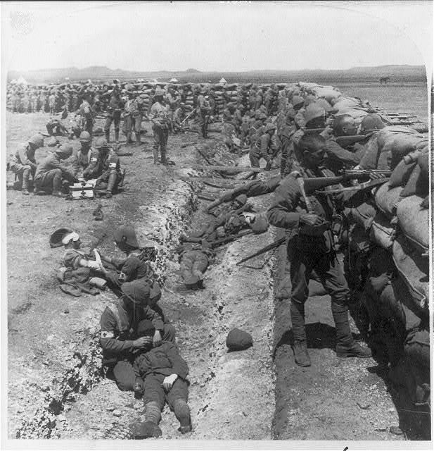 Royal Munster Fusiliers fighting from behind the redoubt at Honey Nest Kloof, South Africa. Feb. 16, 1900