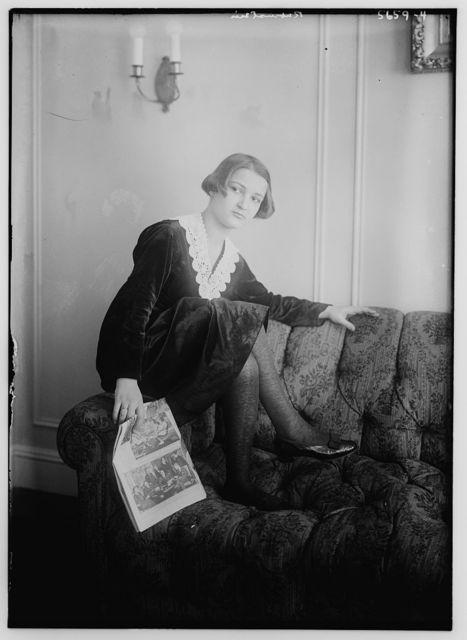 Rubestein [seated on arm of sofa]
