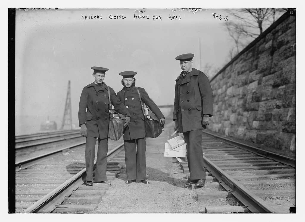 Sailors at train tracks going home for Xmas