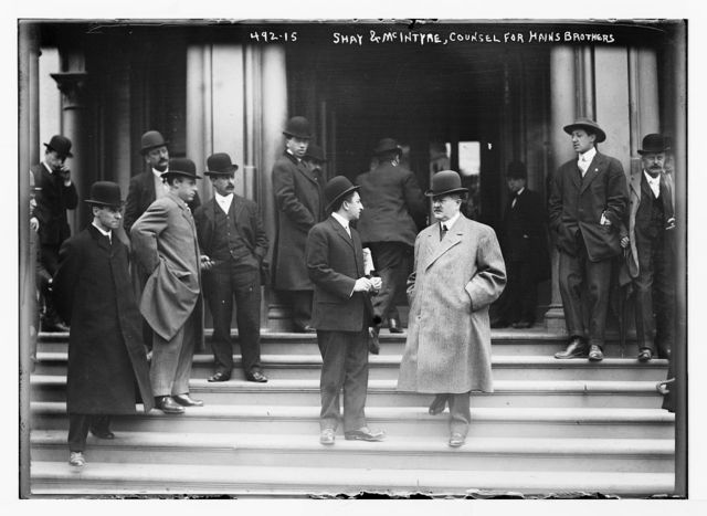 Shay and McIntyre, counsel for Hains Brothers [on steps of courthouse, New York]