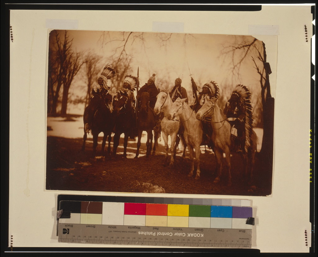 [Six tribal leaders (l to r) Little Plume (Piegan), Buckskin Charley (Ute), Geronimo (Chiricahua Apache), Quanah Parker (Comanche), Hollow Horn Bear (Brulé Sioux), and American Horse (Oglala Sioux) on horseback in ceremonial attire]