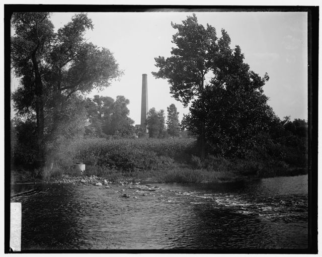 [Smokestack by river, probably the Huron River, Ypsilanti, Michigan]