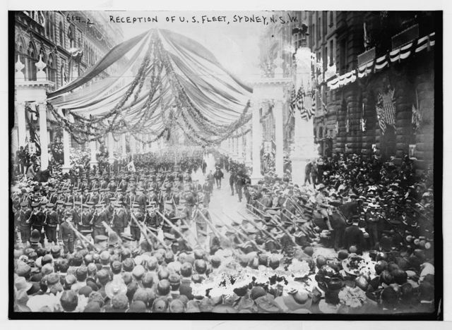 Streamer bedecked street and processions in reception to U.S. Fleet