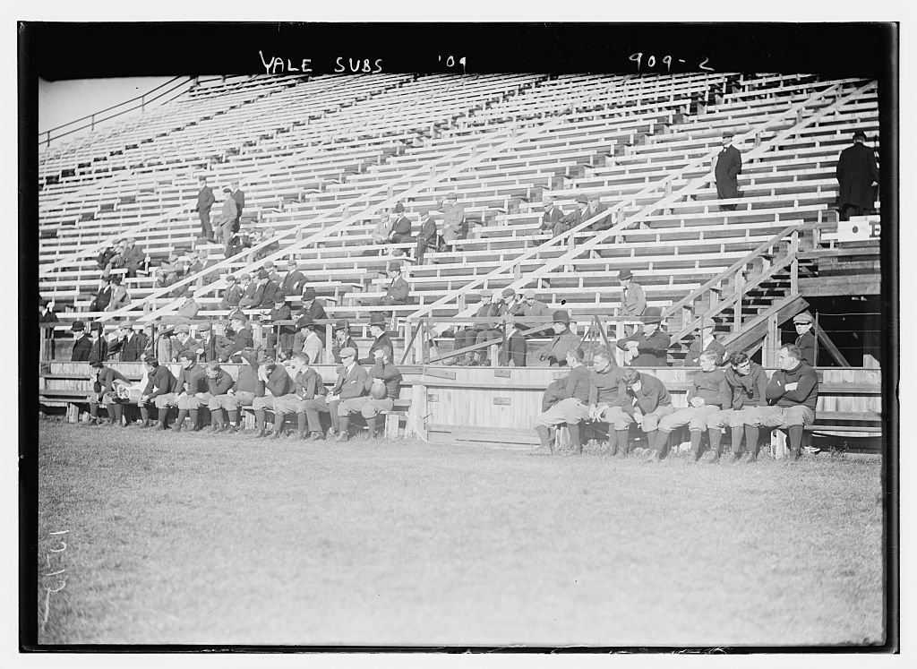 Substitutes for Yale Varsity football team on bench, New Haven, Conn.