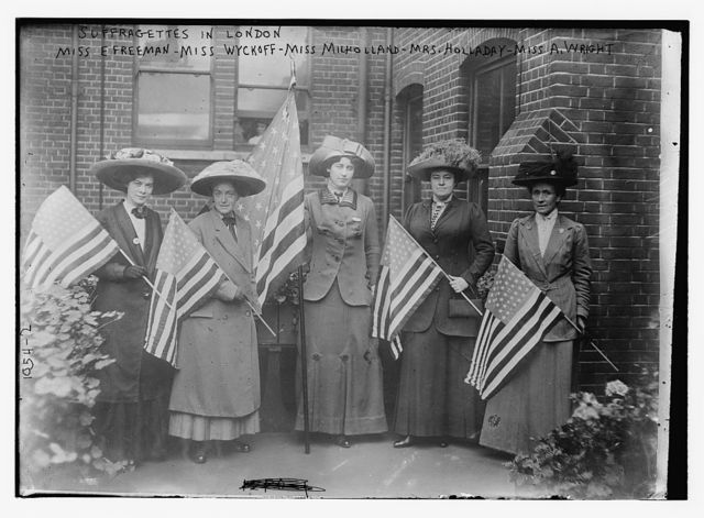 Suffragettes holding flags:  Miss E. Freeman, Miss Wyckoff, Miss Milholland, Mrs. Holladay, and Miss A. Wright