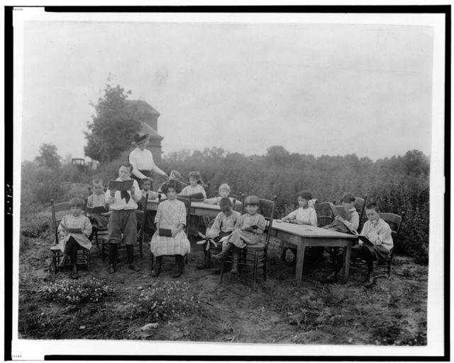 T.B.C. children attending the little red school house [...]