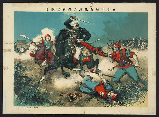 [The Japanese cavalry advancing through fields toward a walled city in China]