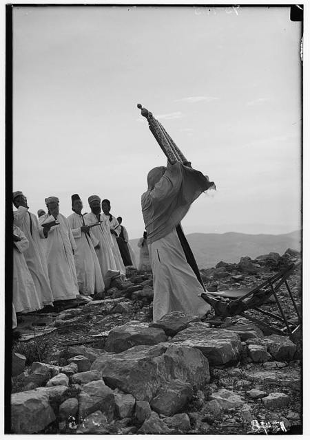 The Samaritan passover on Mt. Gerizim. High Priest exposing the scroll to the congregation