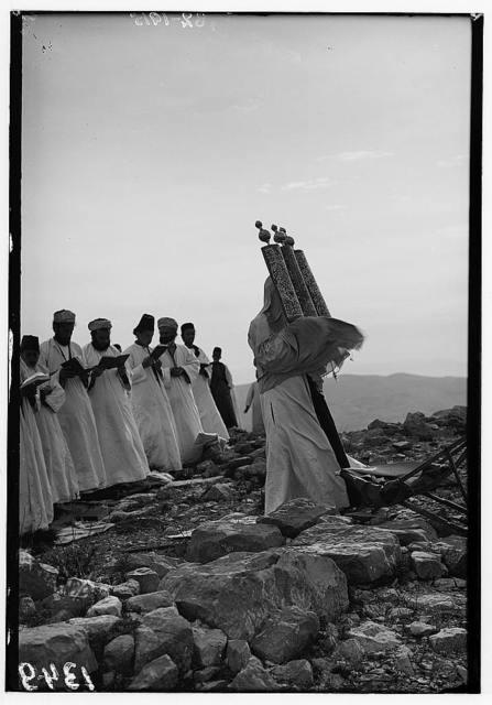 The Samaritan passover on Mt. Gerizim. High priest kissing the sacred scroll