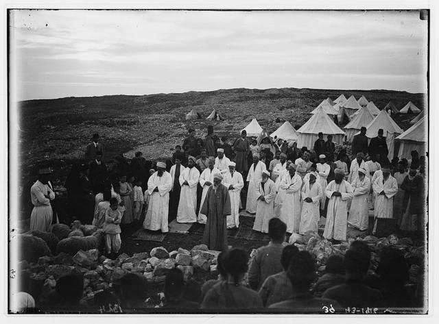 The Samaritan Passover on Mt. Gerizim. High priest praying before the Samaritan assembly.