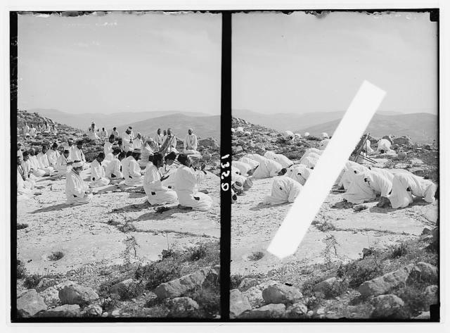 The Samaritan Passover on Mt. Gerizim. Prayer on the holy rock, on knees.