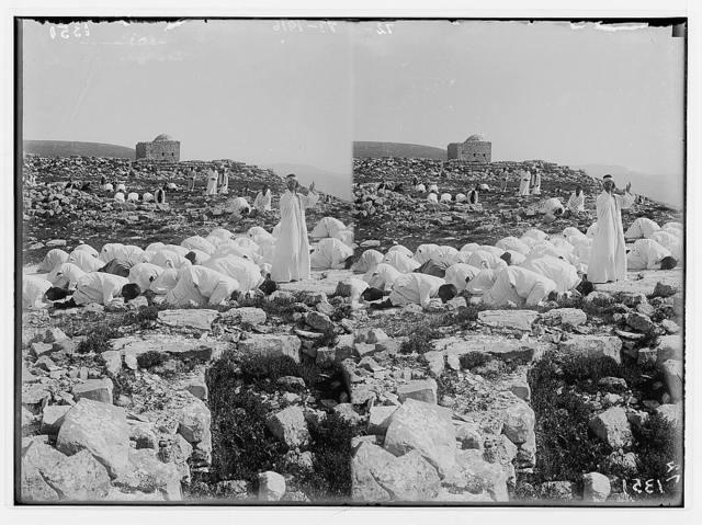 The Samaritan Passover on Mt. Gerizim. Prayer on the holy rock, prostrate.