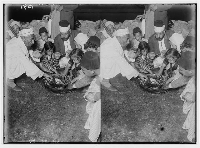 The Samaritan Passover on Mt. Gerizim. Samaritan family eating the sacrifice.