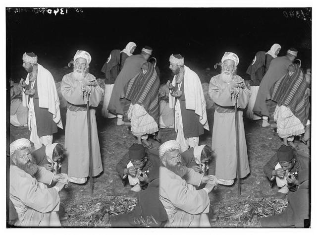 The Samaritan Passover on Mt. Gerizim. The high priest eating with staff in hand.